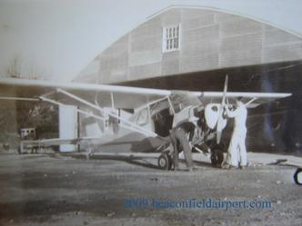Aeronca Champ in front of main Beacon Field Hangar post WWII -- Photo Courtesy Mr. Dick Dodson